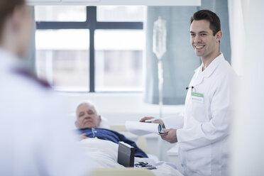 Portrait of smiling doctor in a hospital room - ZEF006256