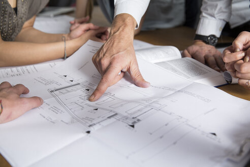 Hand pointing on construction plan - FKF001285
