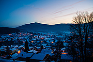 Germany, Bavaria, Bodenmais, village in winter, blue hour - SBDF002189