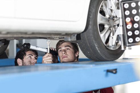 Car mechanics at work in repair garage - ZEF006990