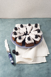 Sliced chocolate cake with creme and blackberries - MYF001095