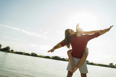 Carefree young couple by the river - UUF005019