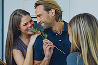 Smiling couple with red rose and daughter - CHAF000850
