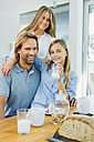 Portrait of happy mother, father and daughter having breakfast together - CHAF000872