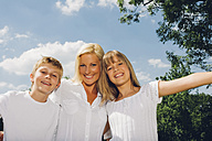 Portrait of happy mother with her children in nature - CHAF000902