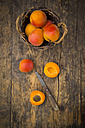 Sliced and whole apricots on wood - LVF003728