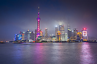 China, Shanghai, Illuminated Skyline of Pudong in rain at Night - NKF000323