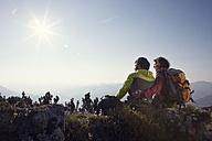 Austria, Tyrol, Unterberghorn, two hikers resting in alpine landscape - RBF002916