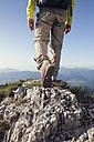 Austria, Tyrol, man hiking at Unterberghorn - RBF002919