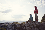 Austria, Tyrol, Unterberghorn, two hikers resting in alpine landscape - RBF002976
