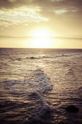 Indonesia, Bali, waves at beach in the evening - KRPF001562