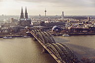 Germany, Cologne, view to skyline with Rhine River and Hohenzollern Bridge in the foreground - MFF002085