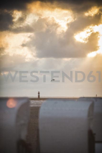 Germany, Mecklenburg-Western Pomerania, Warnemuende, beach chairs on beach at sunset - ASCF000231