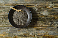 Chia seeds with a wooden spoon in a bowl - ODF001156
