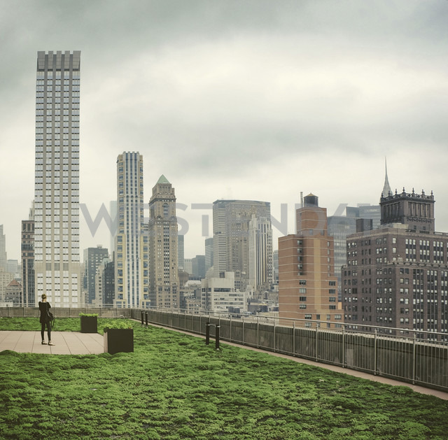 USA, New York City, Woman photographing skyline of Manhattan - ONF000847