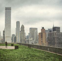 USA, New York City, Woman photographing skyline of Manhattan - ONF000847