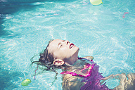 Girl in swimming pool floating in water - SARF002070
