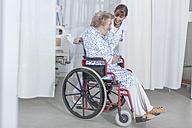 Doctor and elderly patient in wheelchair - ZEF007272