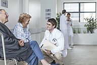 Doctor talking to patients in hospital - ZEF007287