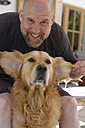 Portrait of man and his Golden Retriever - LBF001151