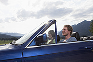 Germany, Bavaria, happy couple in a convertible - RBF003027
