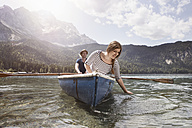 Germany, Bavaria, Eibsee, couple in rowing boat on the lake - RBF003035