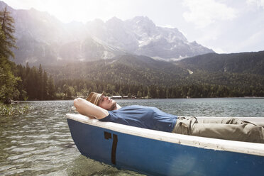 Germany, Bavaria, Eibsee, man in rowing boat on the lake - RBF003040