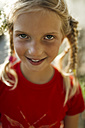 Portrait of smiling little girl with braids - MGOF000394