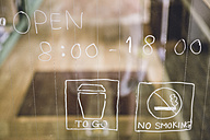 Japan, information on glass pane of a coffee shop - FLF001198