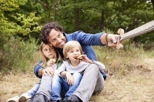Father with two children in the nature holding wooden sword - MFRF000270