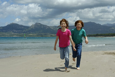 France, Corsica , Calvi, two children running at seafront - LBF001157