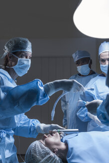 Surgical team preparing patient for operation - ZEF007365