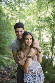 Portrait of young couple in the forest - RAEF000245