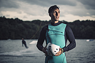 Portrait of young wakeboarder with safety helmet - MADF000490