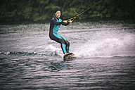 Young man wakeboarding - MADF000495
