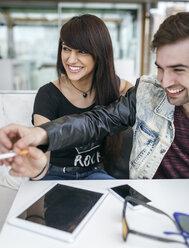 Spain, Gijon, young couple having fun - MGOF000399