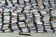 Pile of office files, broom - ASF005675
