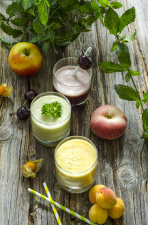 Cherry smoothie, apricot peach smoothie, parsley mint smoothie and fruits - ODF001186