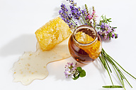 Glass of honey, honeycomb and wild flowers - CSF026023