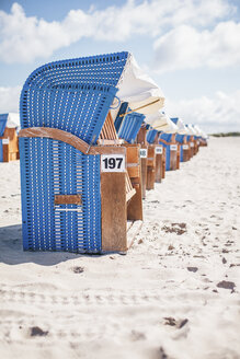 Germany, Warnemuende, hooded beach chairs on the beach - ASCF000297