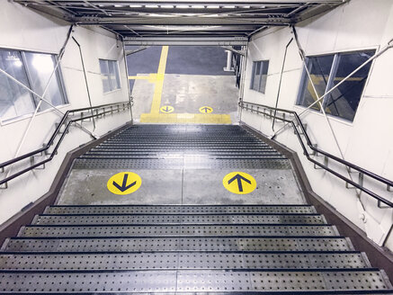 Japan, yellow arrow signs at metro station - FL001176