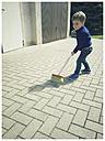 Toddler boy with broom - ABAF001853