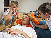 Two little boys playing with their mother at home - LAF001465