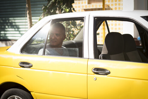 Mexico, Puerto Vallarta, tourist sitting in taxi looking through window - ABAF001881
