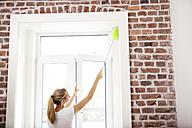 Woman dusting window - MFRF000347