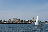 Germany, Warnemuende, Old Lighthouse, dinghy, sailing boat at harbour entrance - FR000306