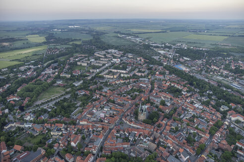 Germany, aerial view of Quedlinburg with St. Nicholas' Church in the evening - PVCF000536