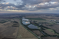 Germany, Wegeleben, aerial view of water-filled gravel pit in the evening - PVCF000544