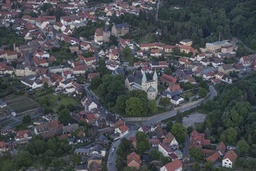 Germany, aerial view of Gernrode with collegiate church St. Cyriakus in the evening - PVCF000570
