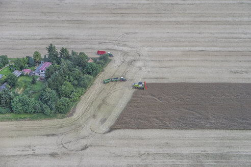 Germany, aerial view of combine harvester at work on a field - PVCF000603